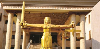 Two remanded in prison for stabbing woman to death