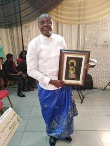 Mr. Isine with Award