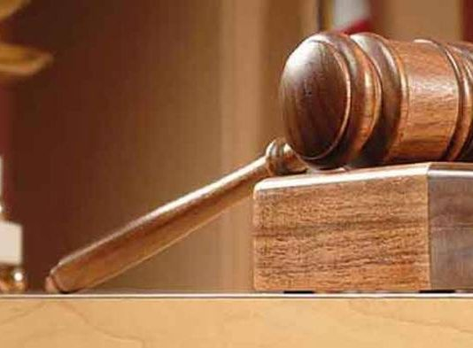 Two Pastors Arraigned For Holding Services