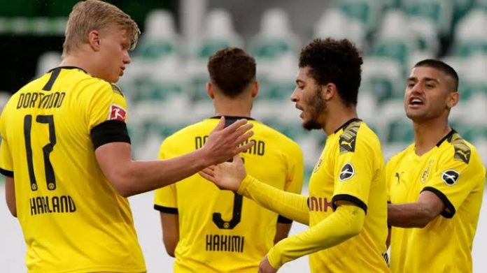Dortmund Ease Past Wolfsburg 2-0 To Stay In Title Hunt