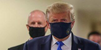 Trump Shocks Critics, Wears Mask In Public